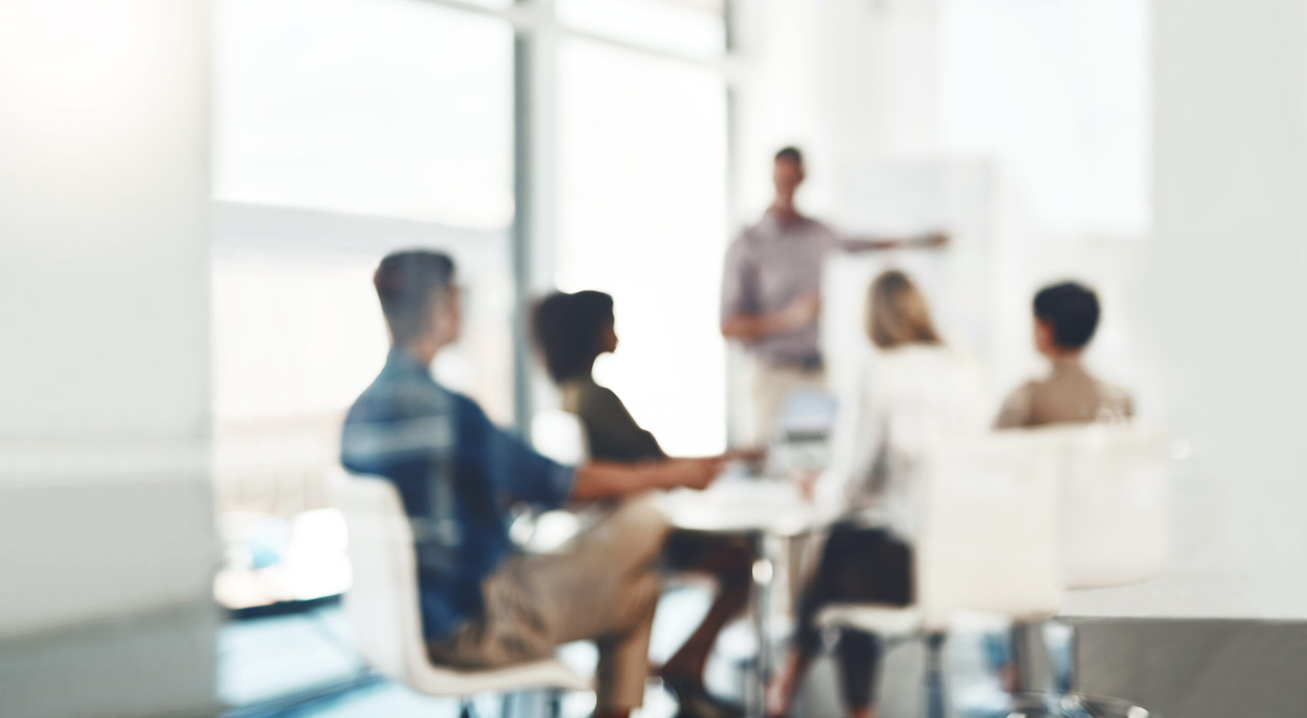 Defocused shot of a group of businesspeople having a meeting in an office. Planning process. Funnel sizing.